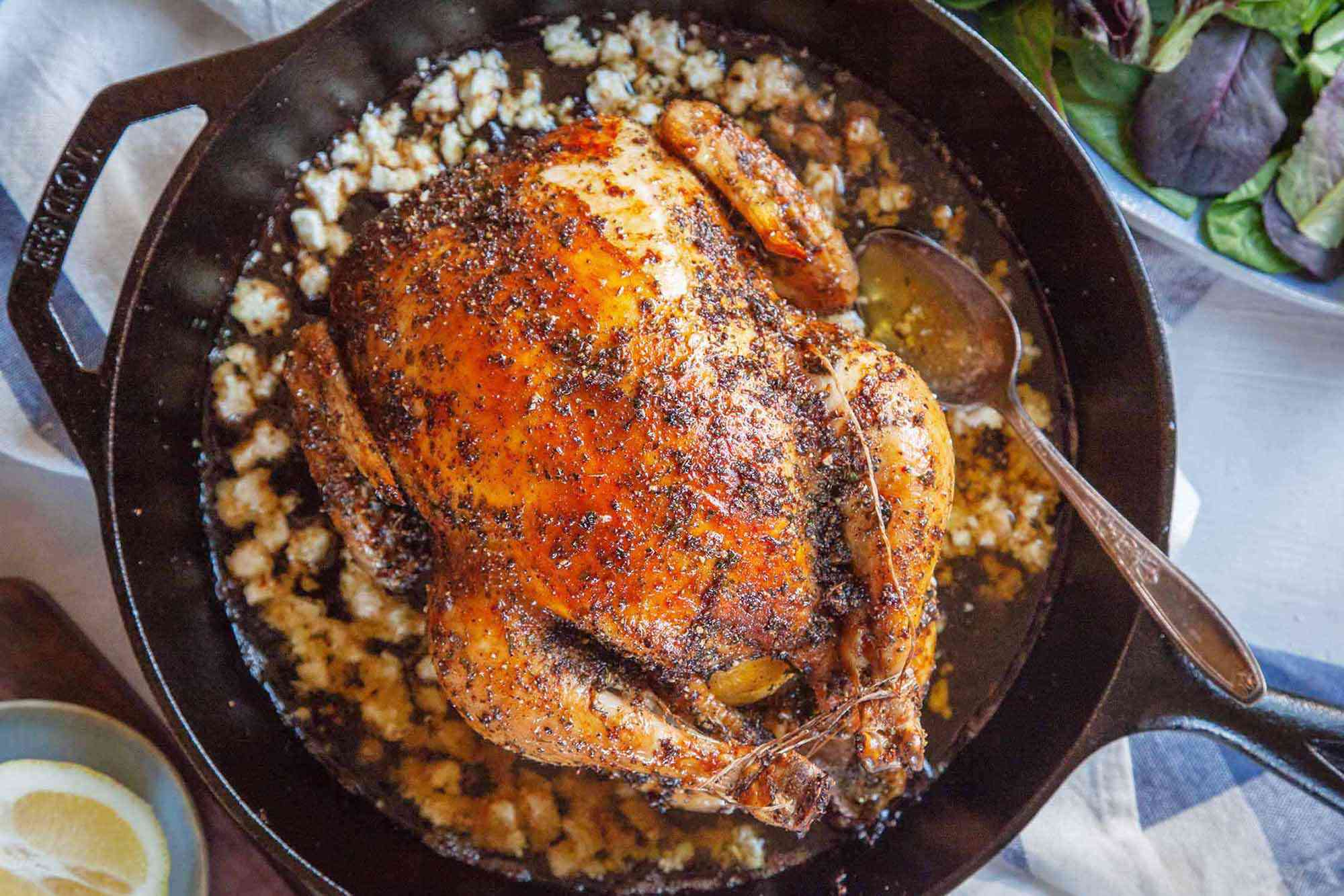 feta brine and roast chicken in a cast iron skillet