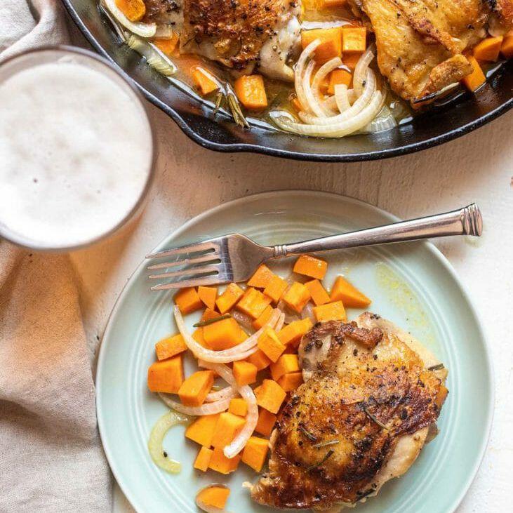 easy weeknight dinner cider-braised chicken thighs in skillet