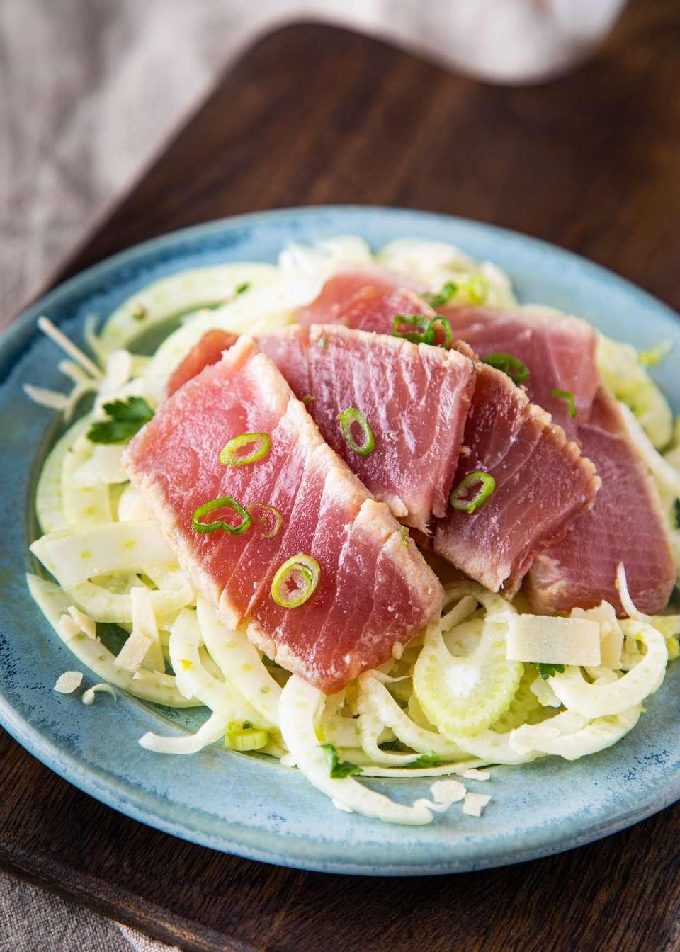 A plate of ahi tuna served over fennel salad.
