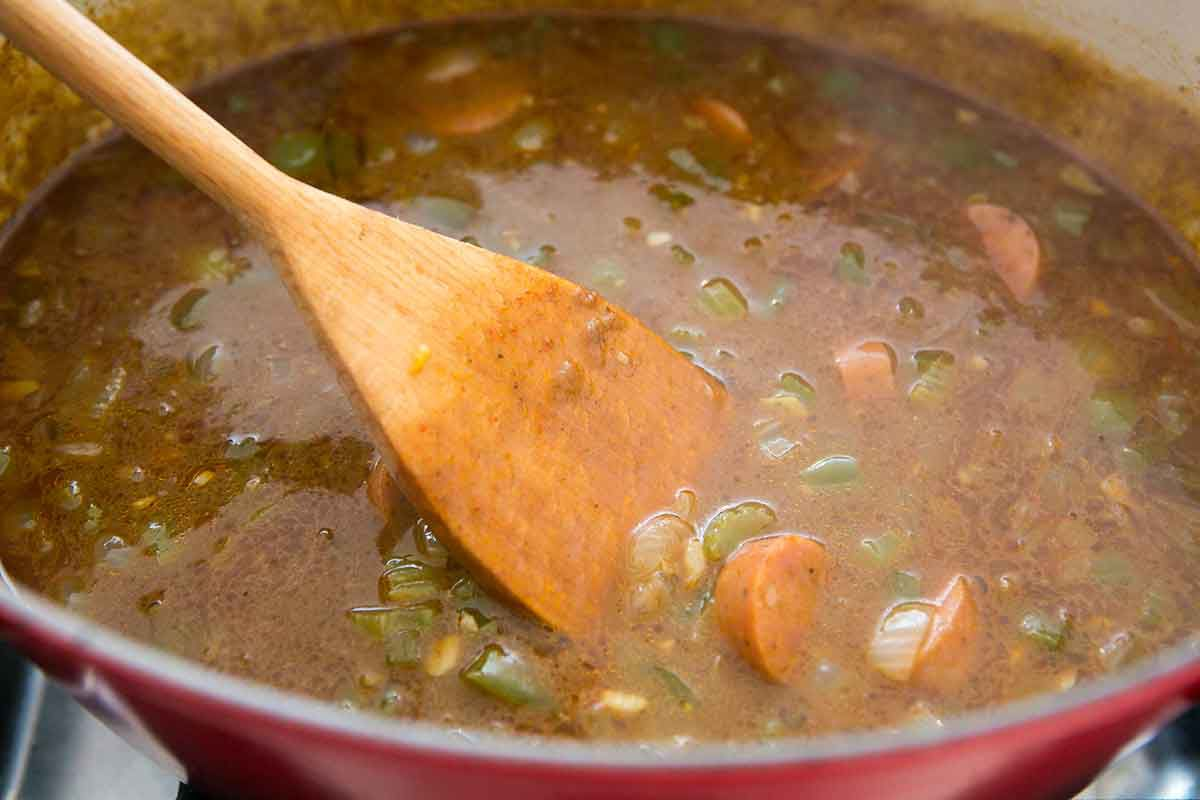Add the sausage to the stew with the vegetables for shrimp gumbo