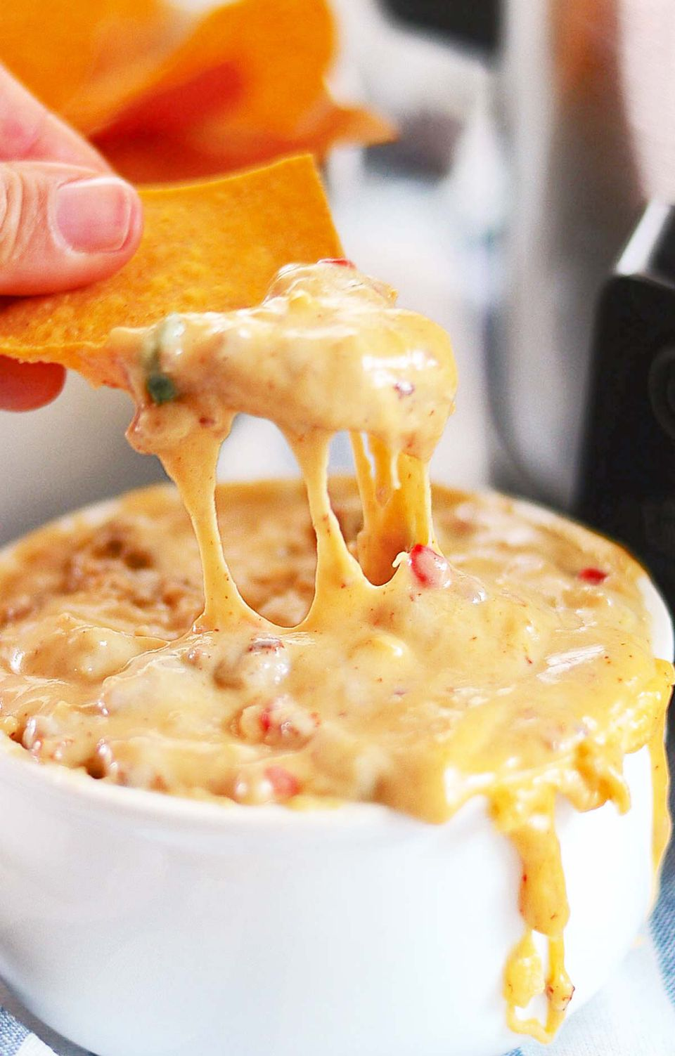 Crockpot Cheesy Dip with beer and brats