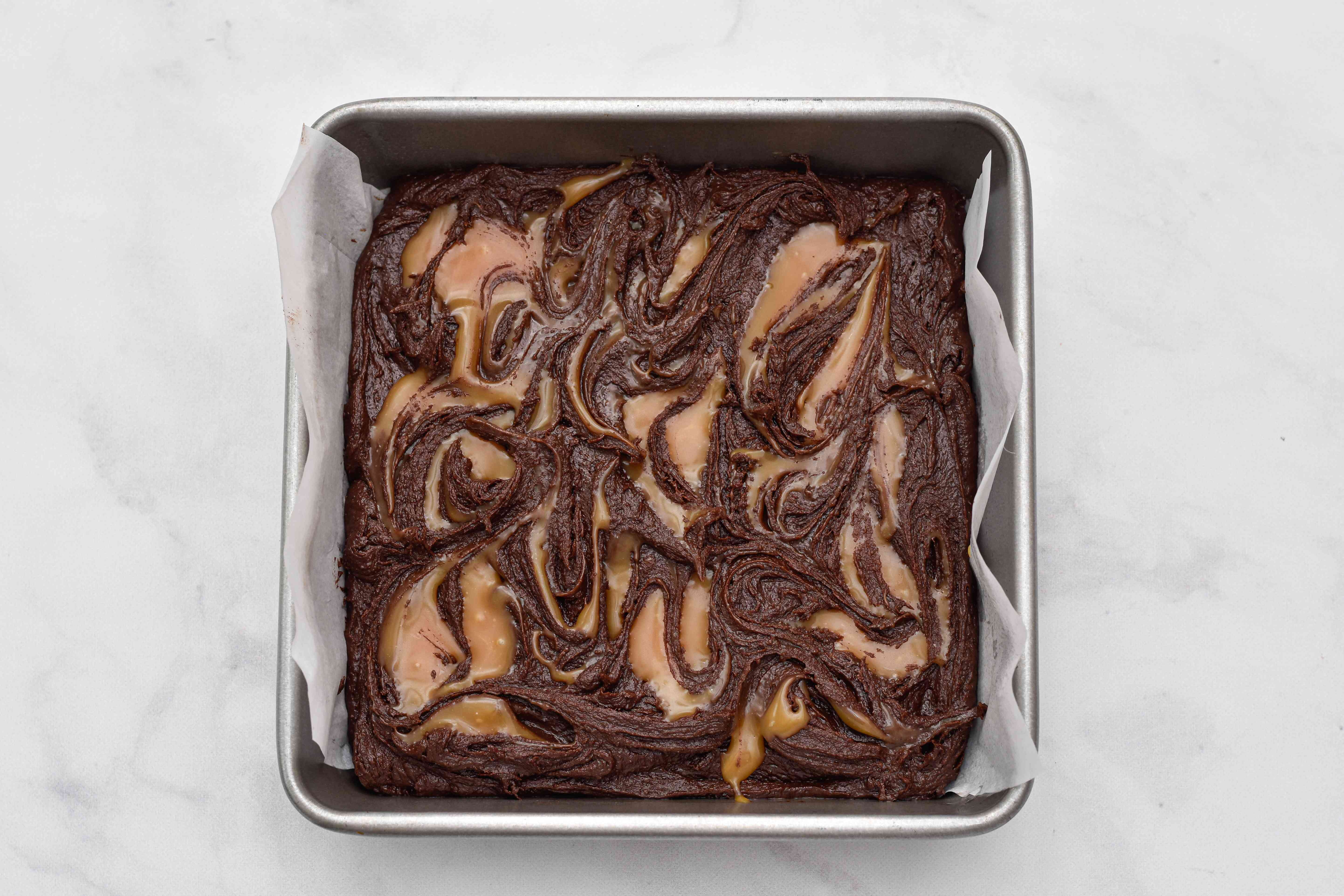 Fudgy Caramel Swirl Brownies in a pan