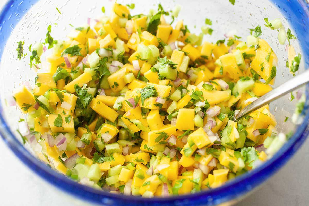 Grilled Salmon Fillet with Mango Salsa - cucumber and mango salasa in a bowl