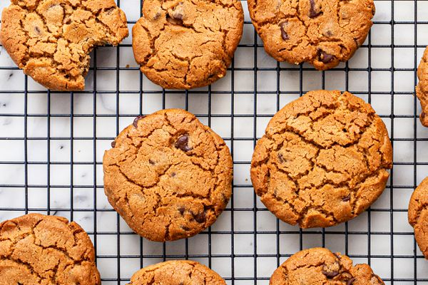 Flourless Peanut Butter Cookies with Chocolate Chips cooling on a rack.