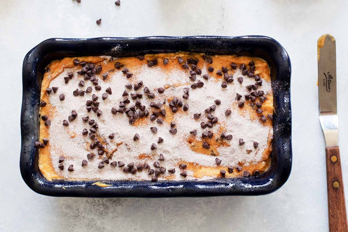 Sugar topped chocolate chip bread batter in a loaf pan.