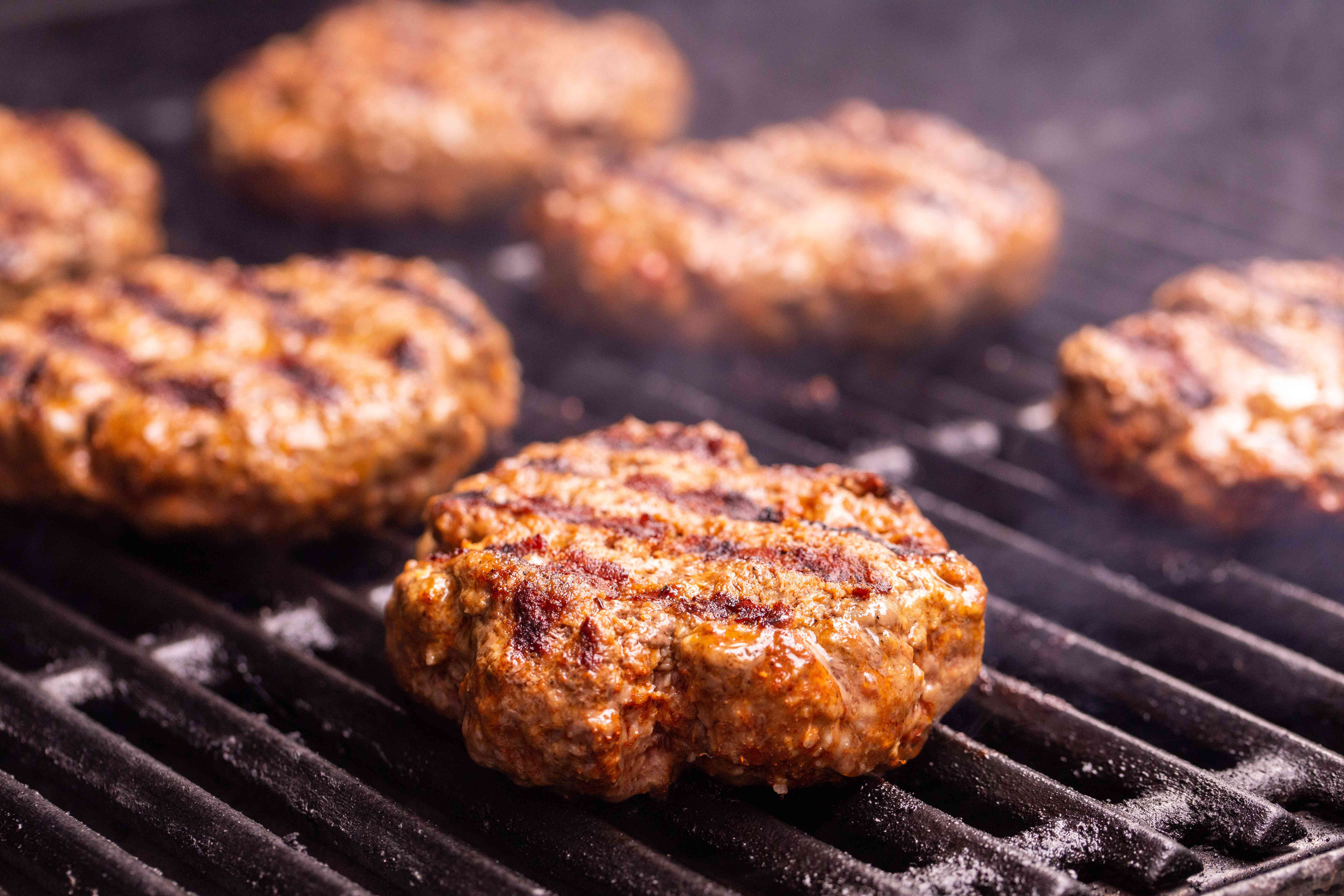 Burger patties on the grill for Nacho Mexican Burger.