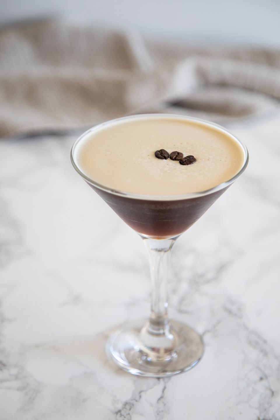 Espresso Martini Cocktail on a marble background.