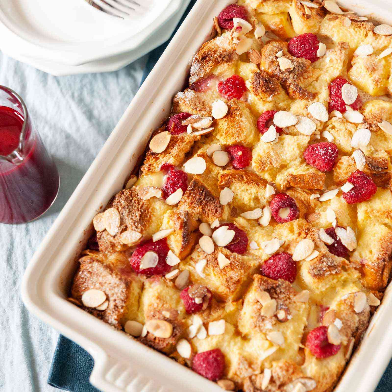 Easy French Toast Casserole -- french toast casserole with raspberries and almonds in baking dish