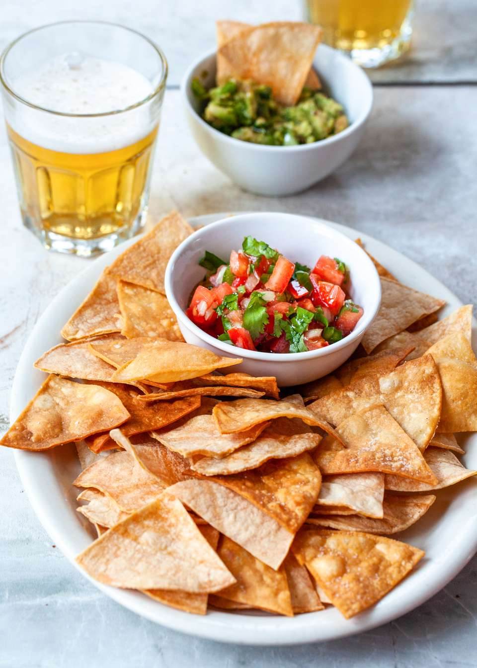 A plate of tortilla chips and salsa.