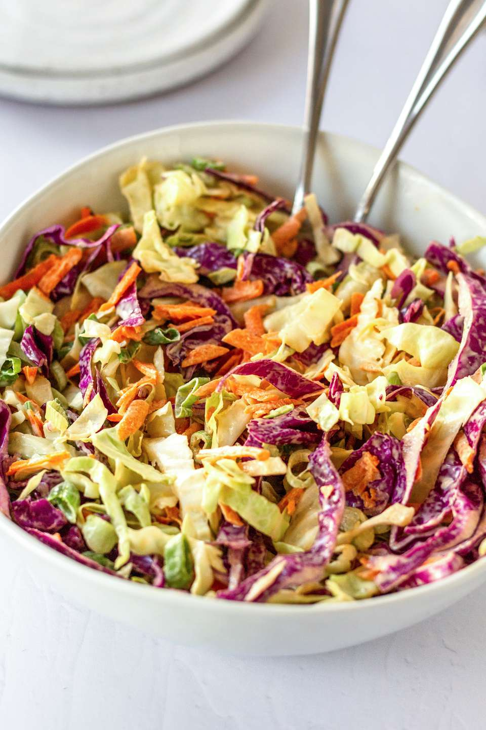 Bright Classic Coleslaw in a white bowl.