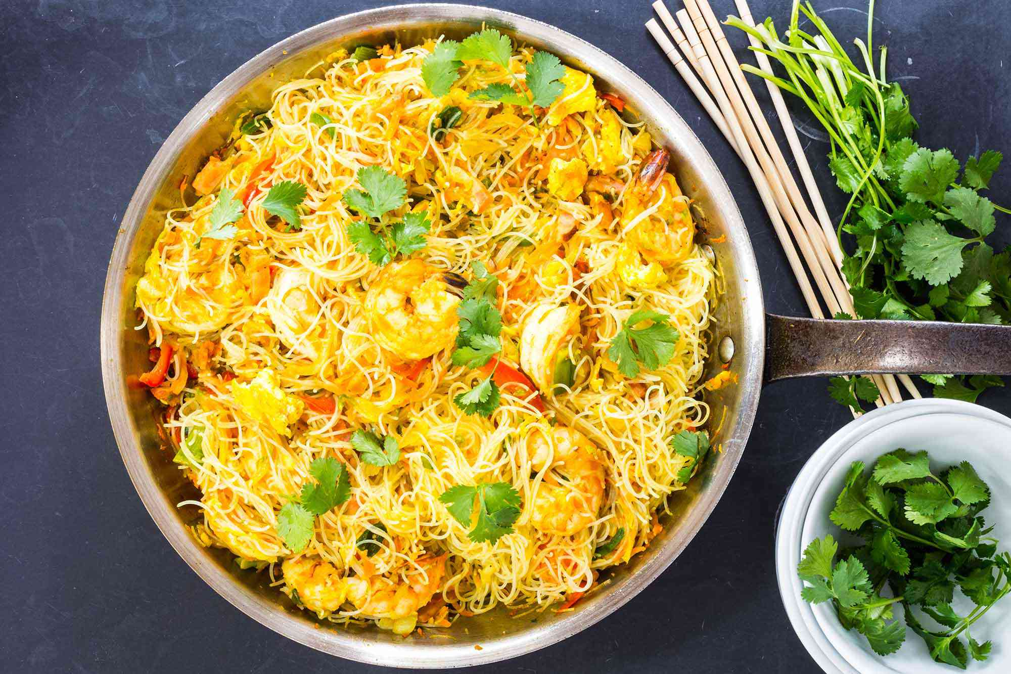Singapore Rice Noodles Recipe with shrimp and cilantro in a skillet
