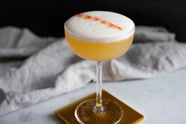 Whiskey sour cocktail with egg white foamy top
