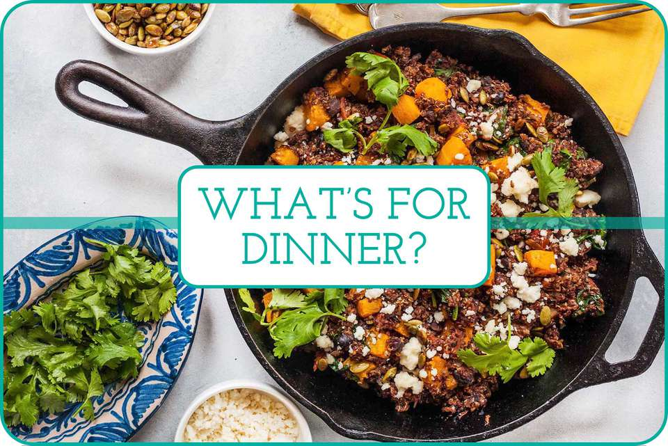 """""""What's For Dinner?"""" with a photo of Butternut Squash and Black Bean Skillet Dinner in a skillet with topping around it."""