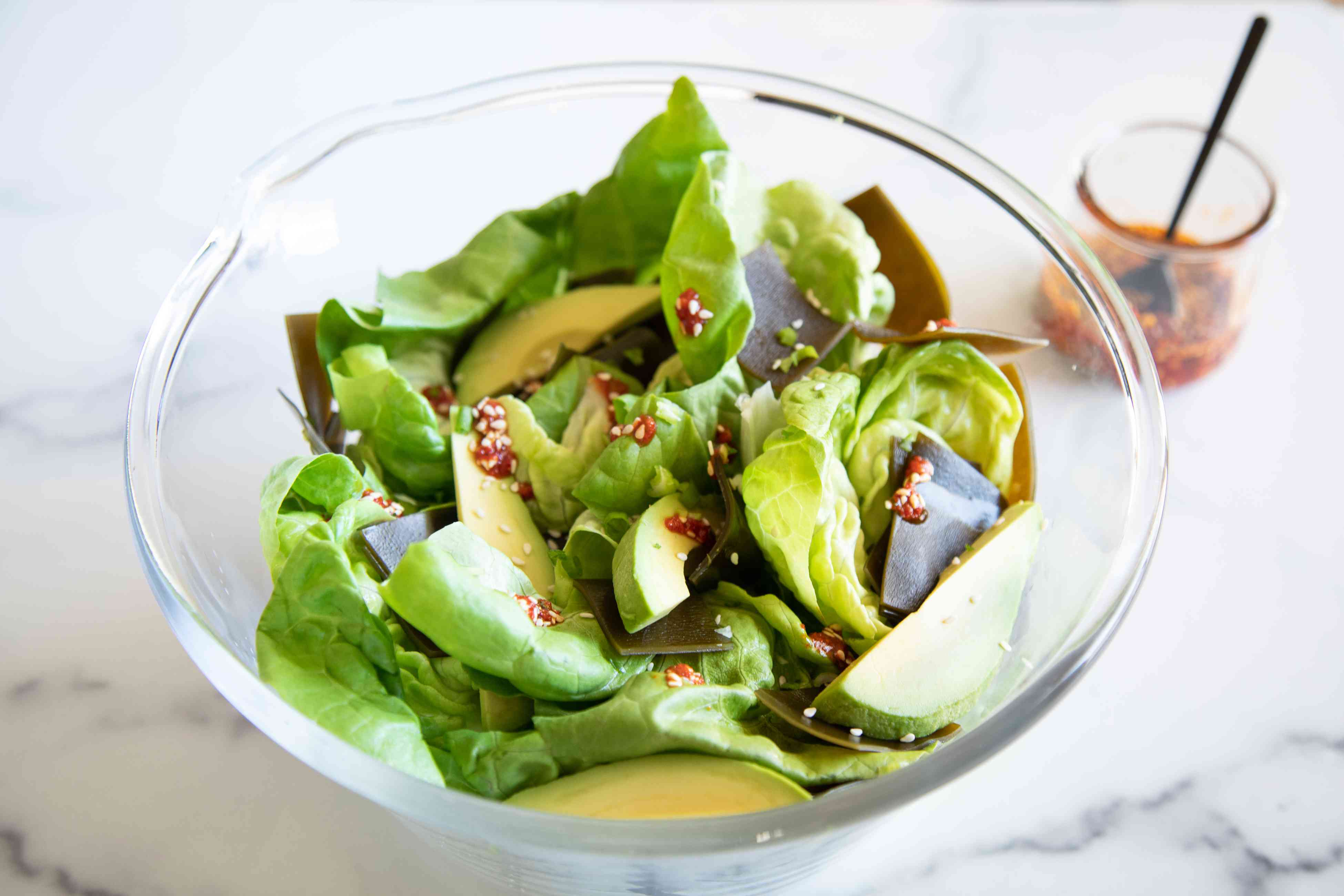 A bowl with lettuce and avocado to make Seaweed Lettuce Salad by Hetty McKinnon.