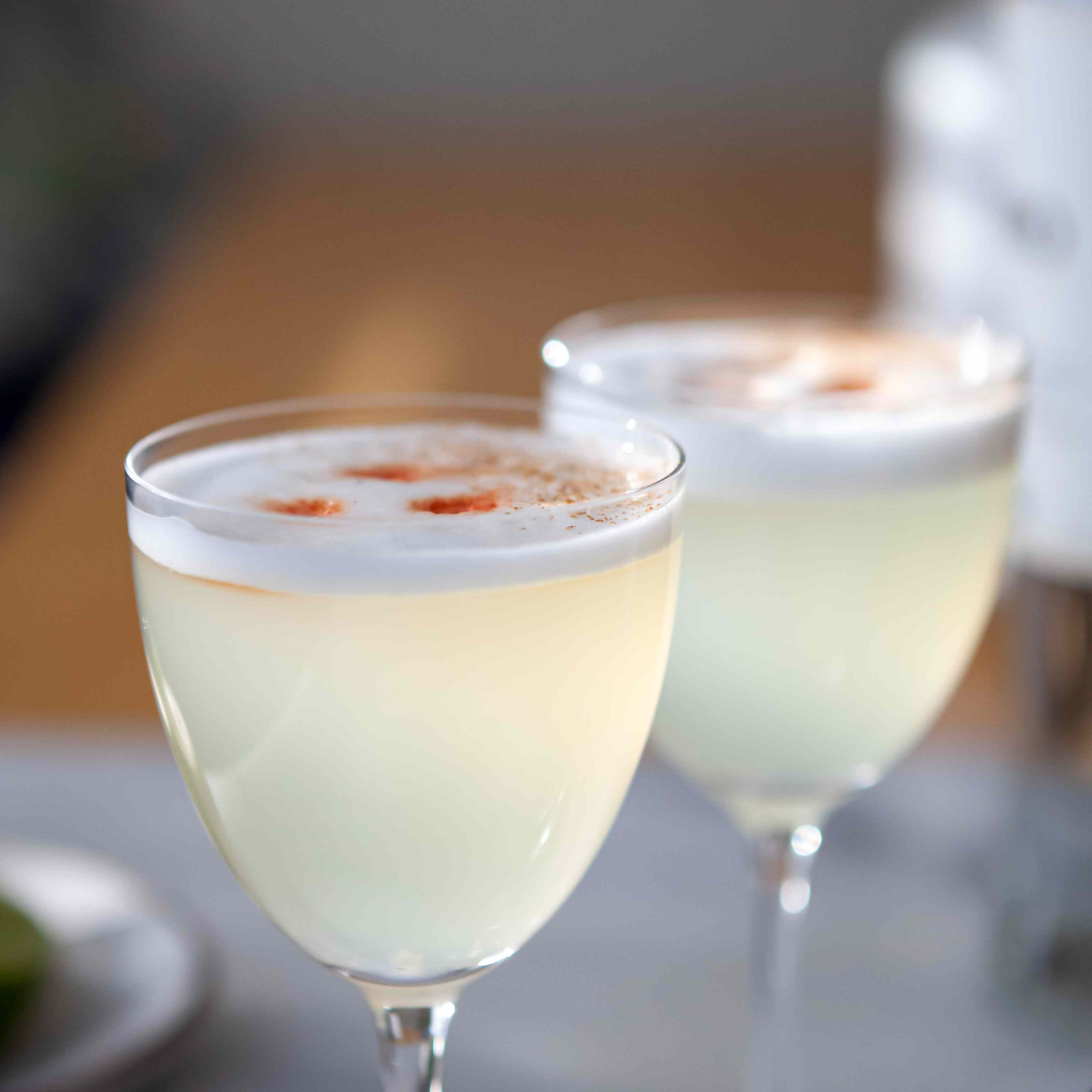 Sideview of two Classic Peruvian Pisco Sour cocktails