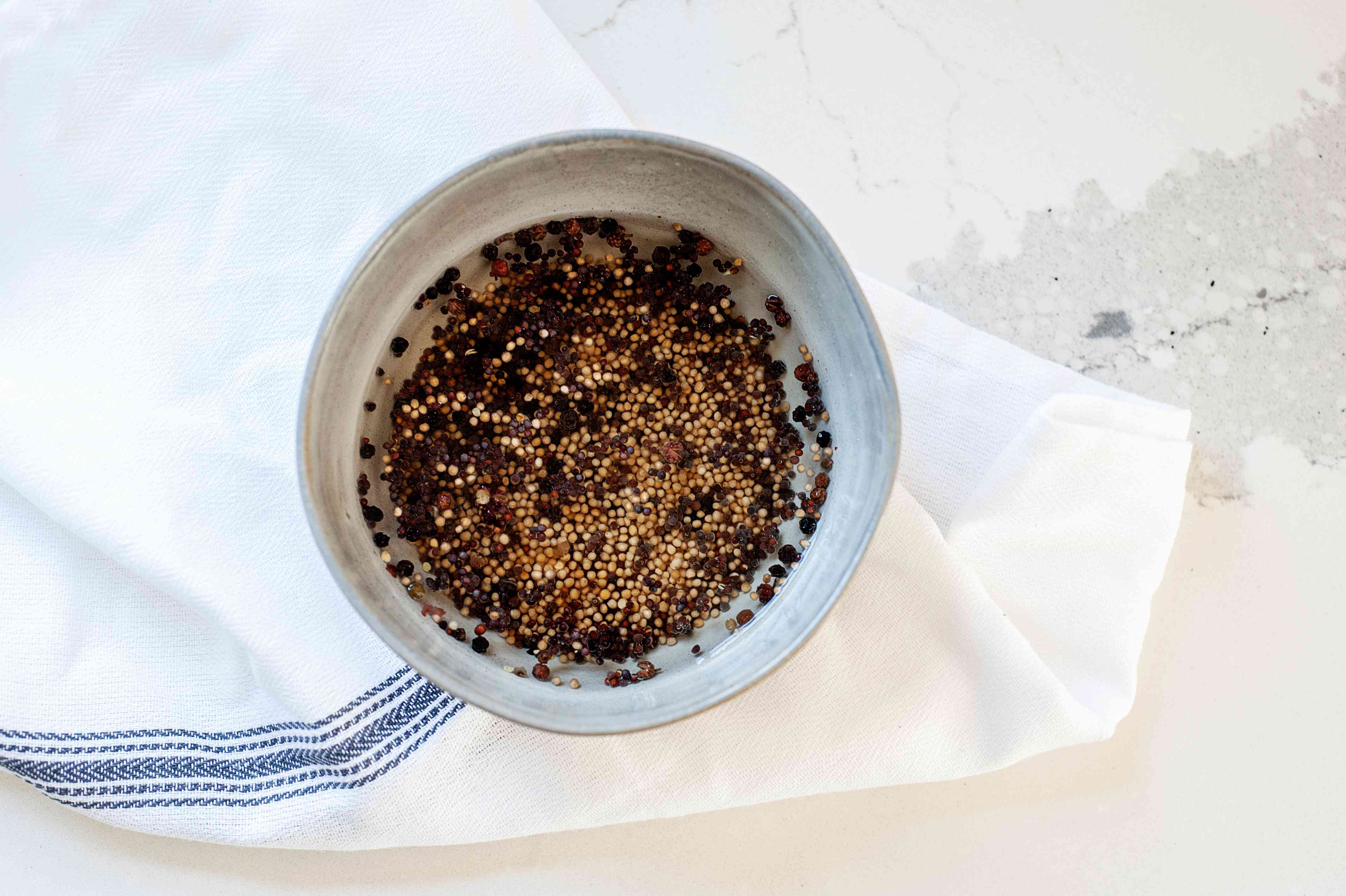 Mustard seeds in a small bowl to make a honey mustard recipe