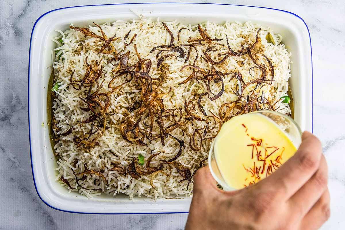 Hyderabadi Chicken Biryani pour the saffron milk over it