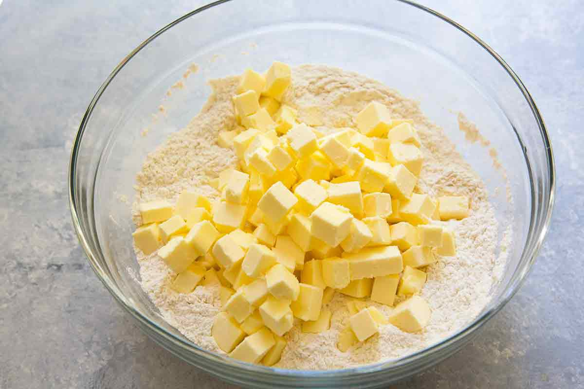 mix butter with flour to make pie dough for american flag pie