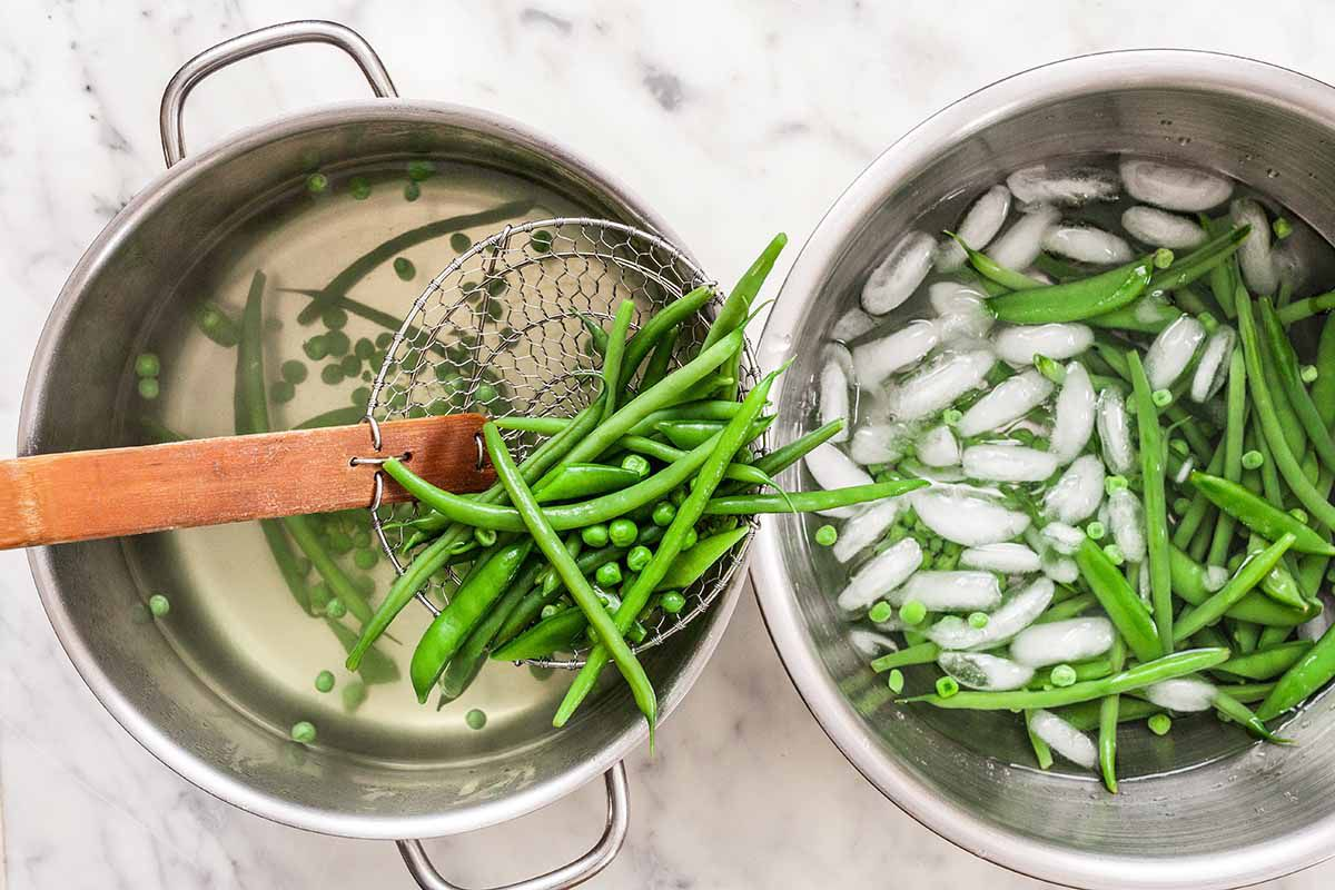 Spring Salad with Radishes - pot of peas and beans next to a bowl of ice water