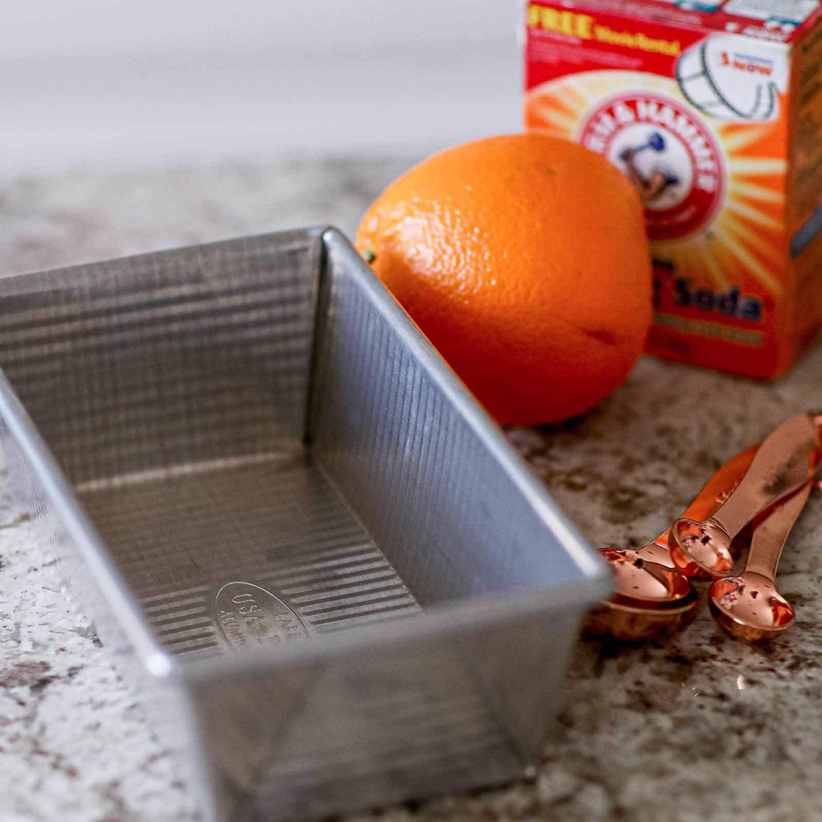 Glass Loaf Pan Guide - aluminum loaf pan with orange and baking soda