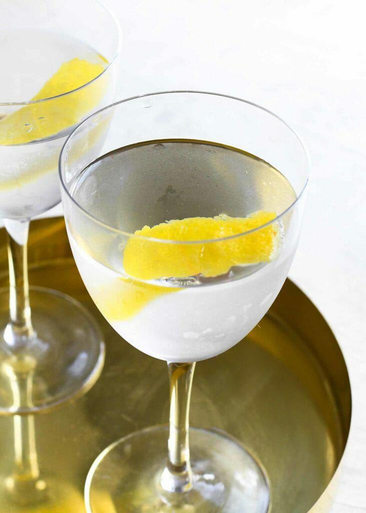 Vodka Martini Shaken Recipe - clear martini on gold tray with lemon garnish