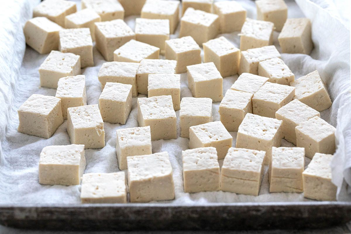 Cubed tofu on a baking sheet to make Vegetarian Stir Fry with Tofu.