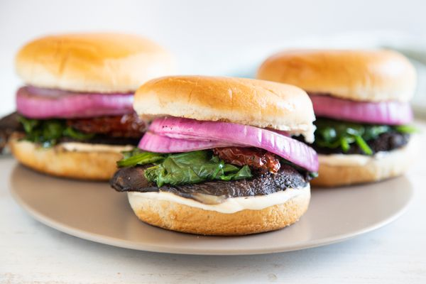 Three mushroom burgers on a platter.