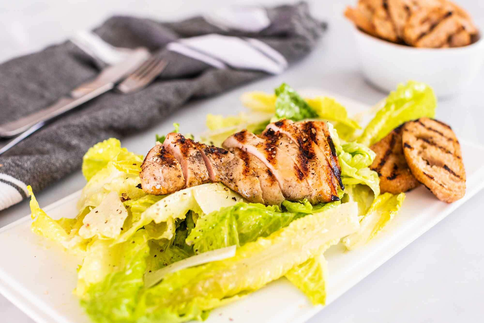Grilled Caesar Salad with Chicken serve the salad
