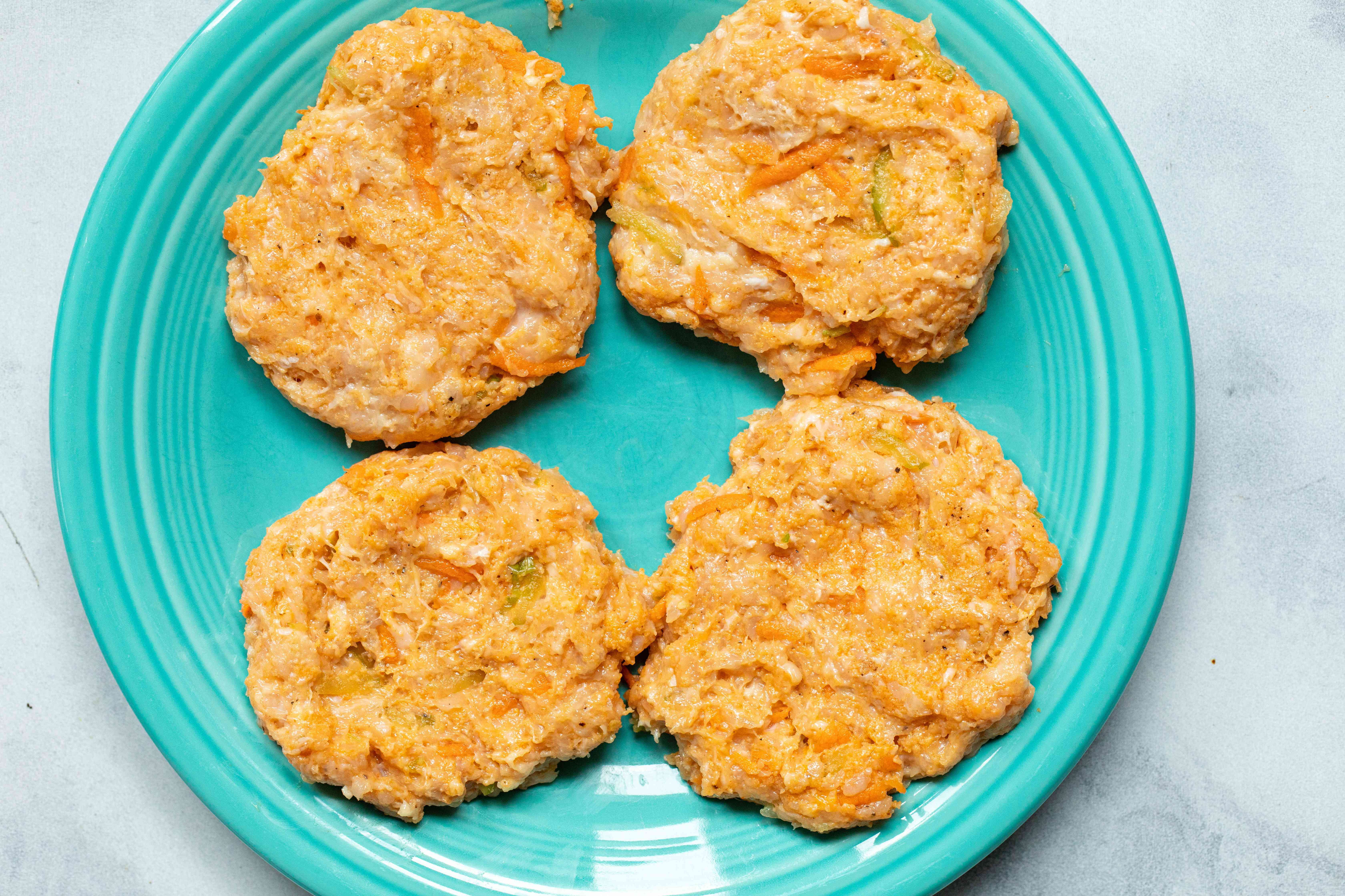 Buffalo chicken burger patties ready to be cooked.