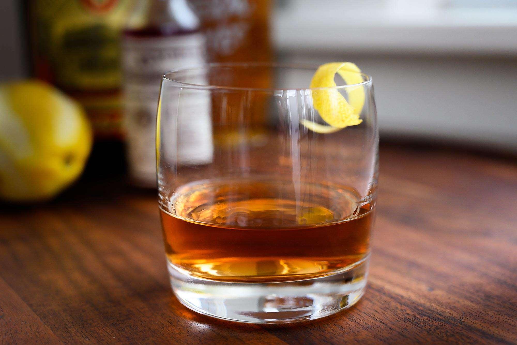 Close up horizontal view of sazarec drink. Sazarec ingredients are in the background.