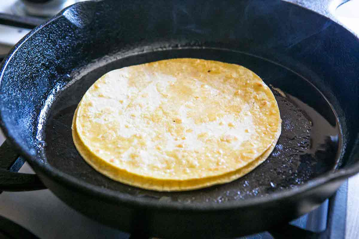 stack tortillas to absorb excess fat for making enchiladas