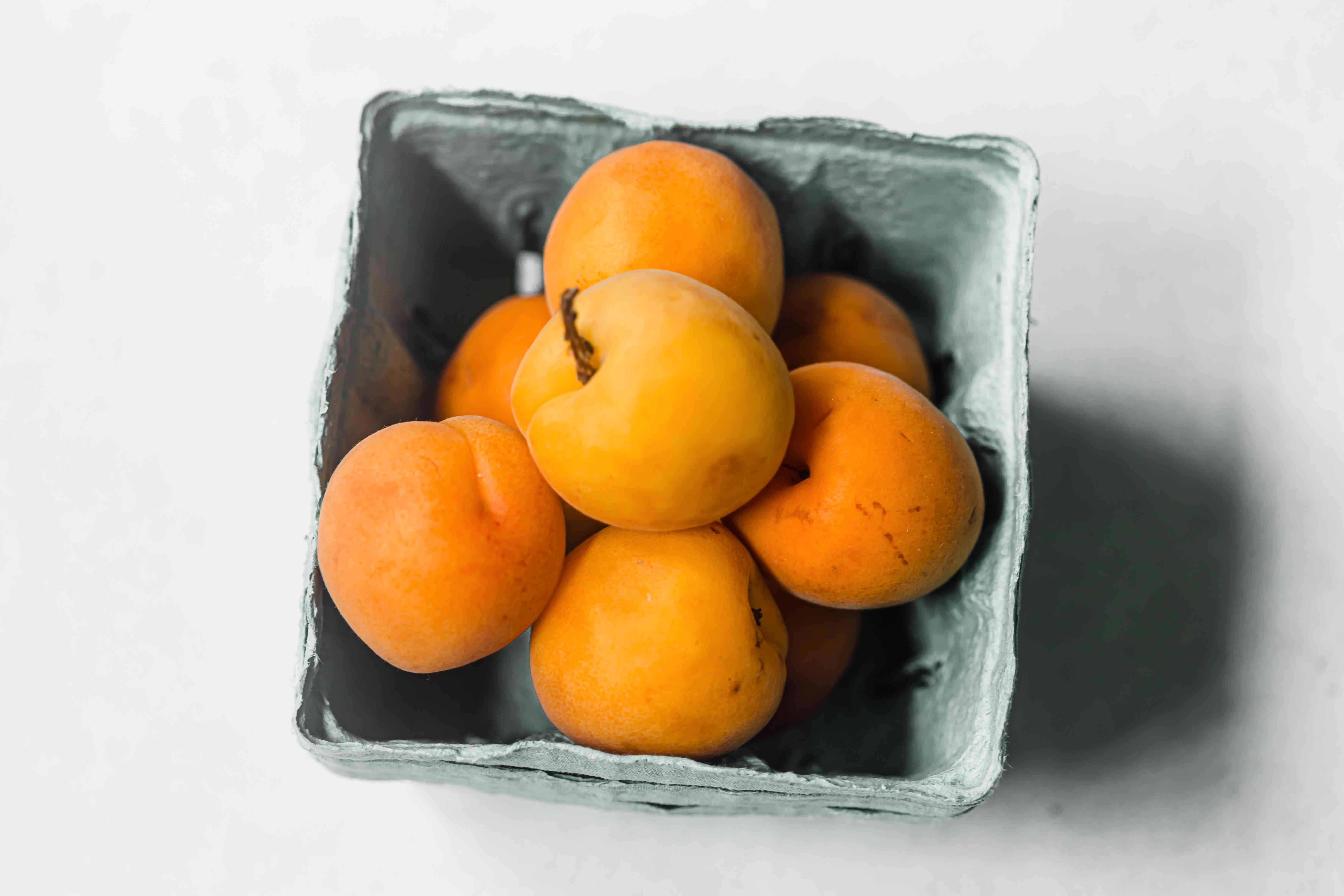 Apricots in a cardboard container