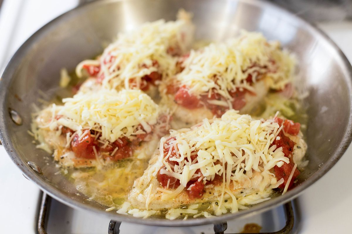 Top the chicken with tomato bruschetta topping and cheese