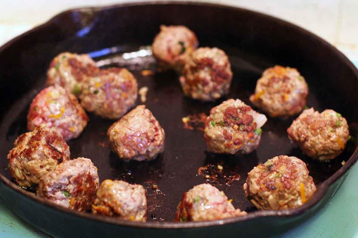 seared greek meatballs in frying pan