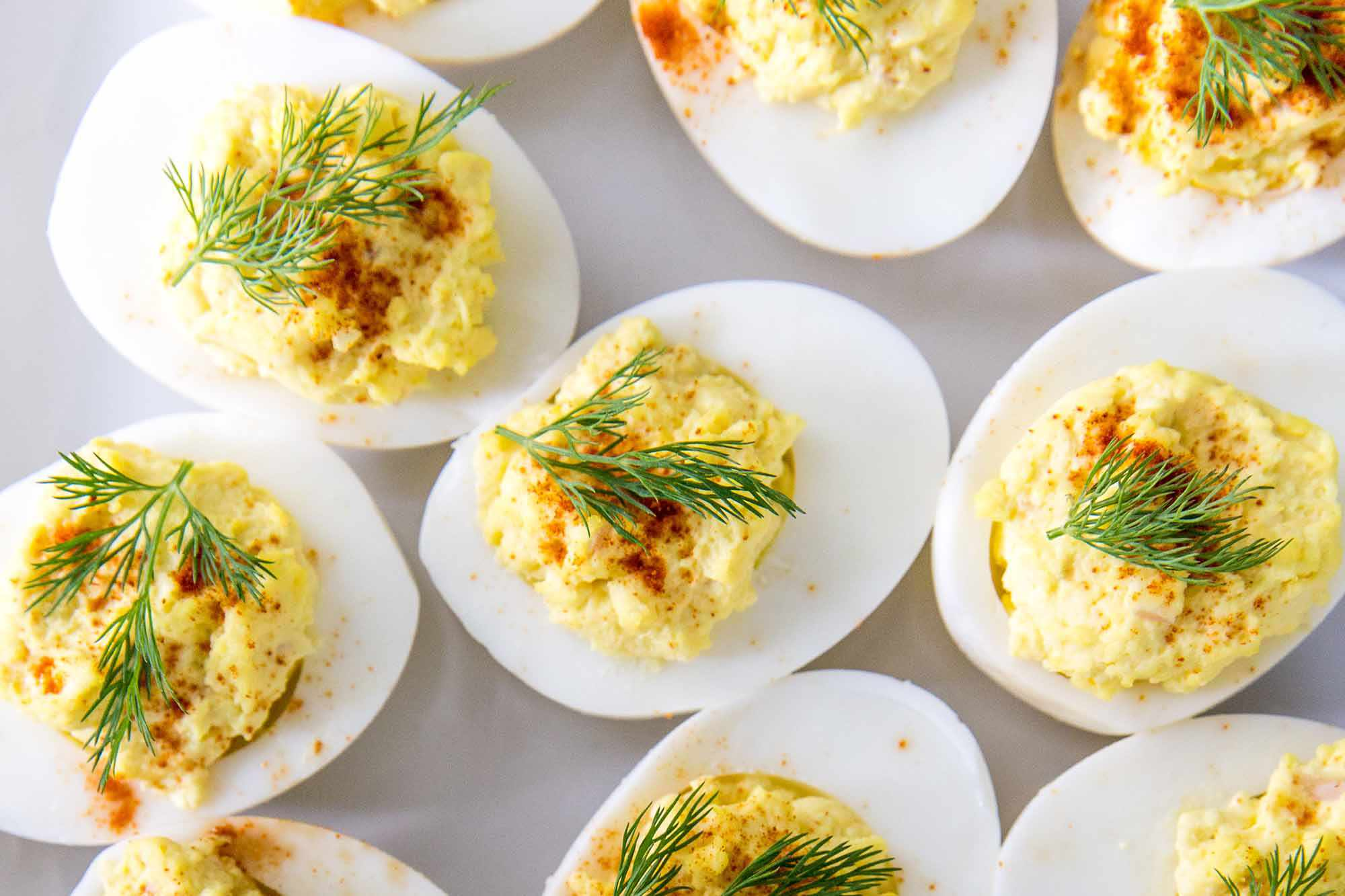 How to Make Deviled Eggs -- Close up of deviled eggs with dill and paprika