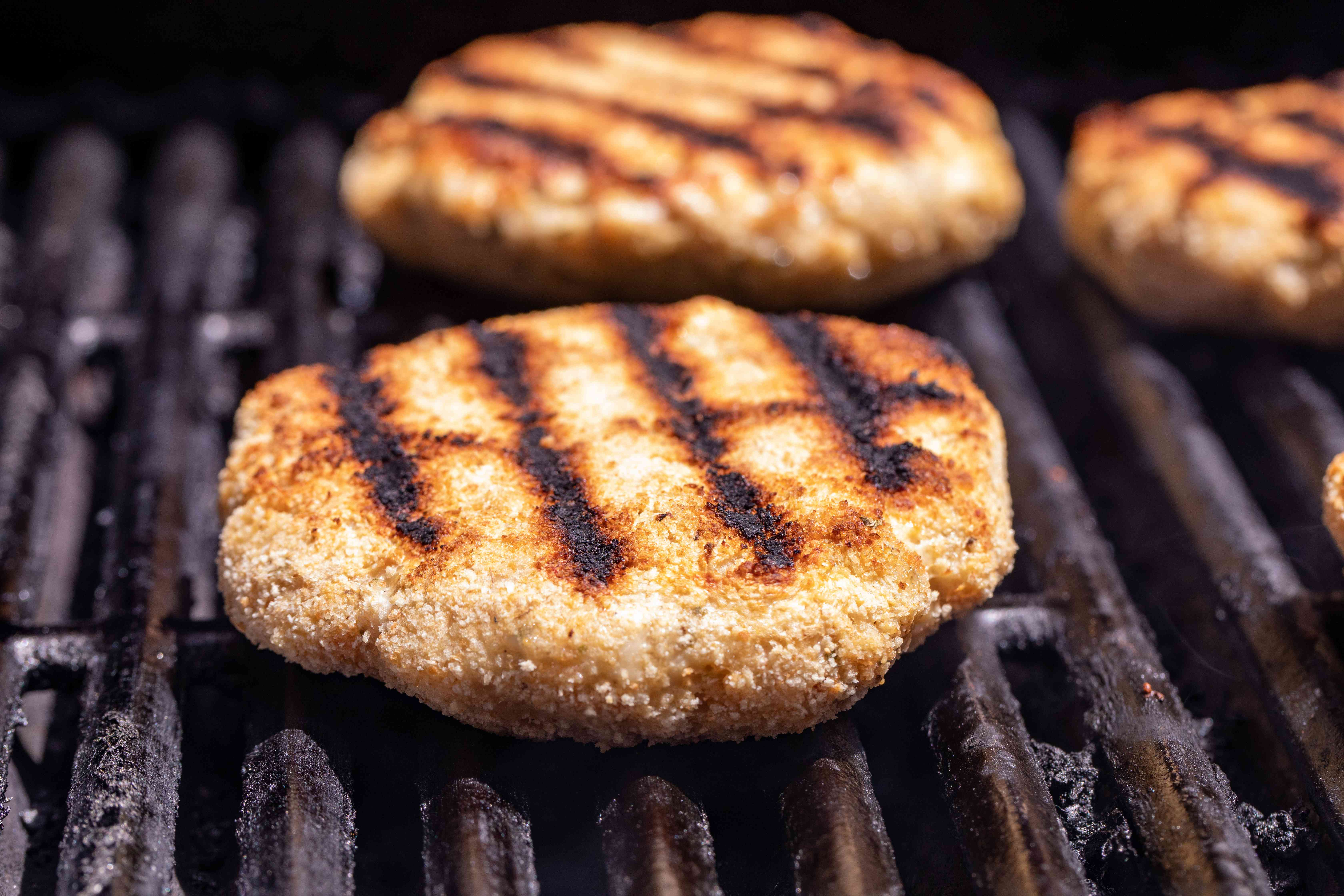 Grilling chicken and herb burgers.