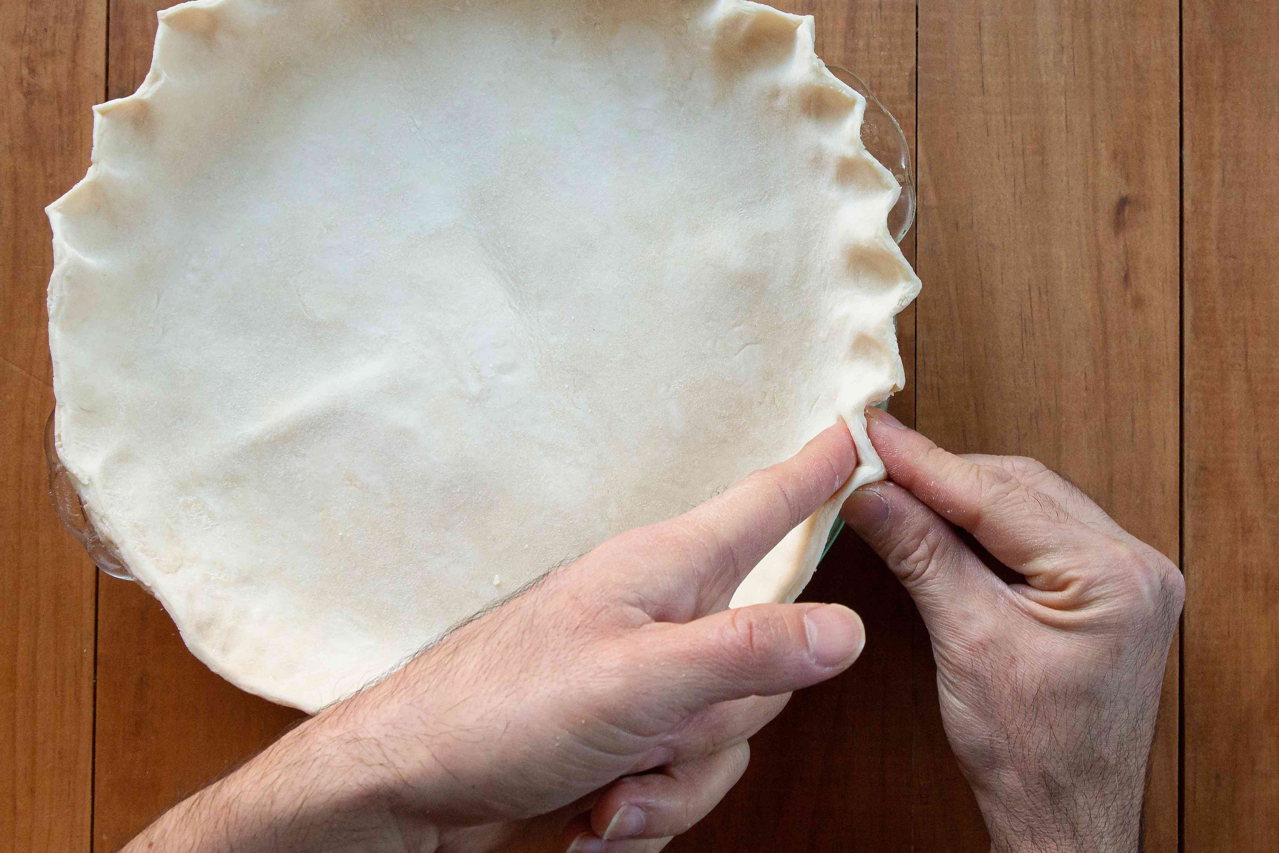 Crimping the top crust of an Easy Lemon Pie.