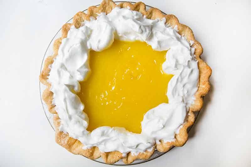 Adding meringue to top of lemon curd filling for lemon meringue pie