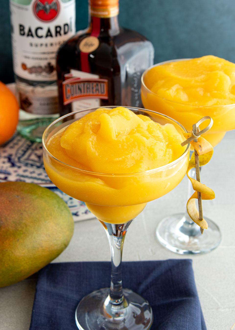 Frozen mango daiquiris in martini glasses.