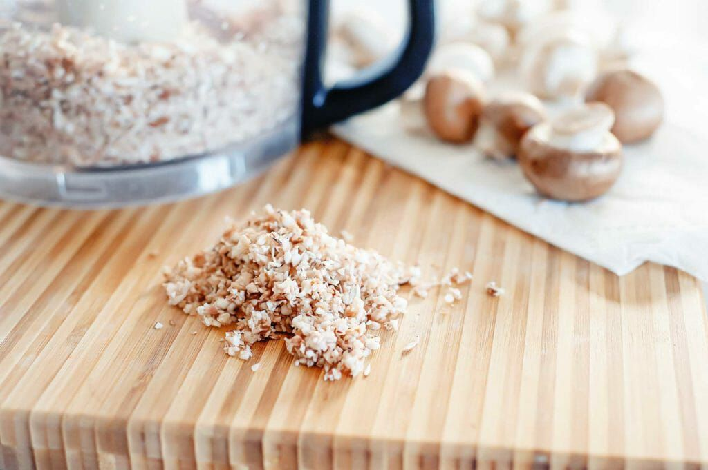 Finely dice mushrooms in a food processor