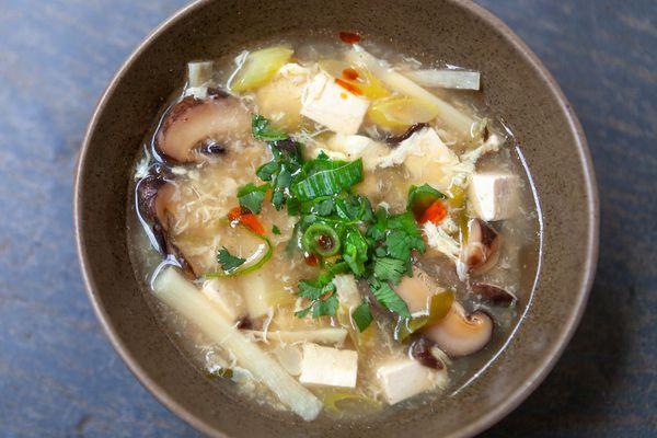 A bowl of hot sour soup.