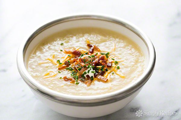 Baked Potato Soup in serving bowl with cheese, onions and bacon