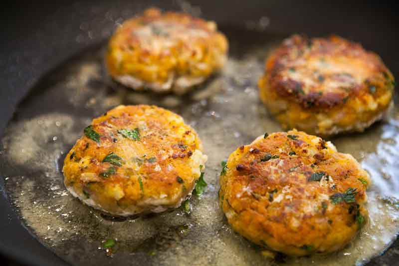 shrimp cakes being fried in oil