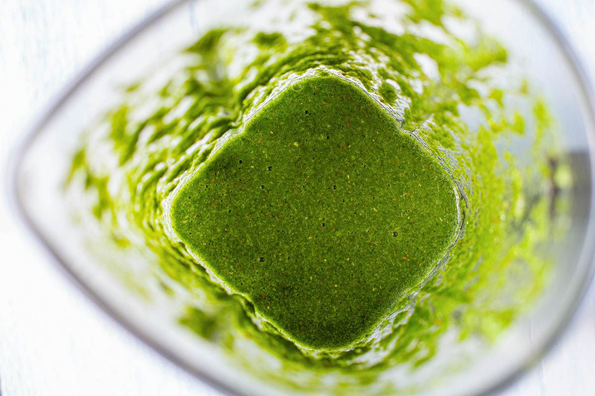 Green chutney made with mint and cilantro for vegetable samosas.