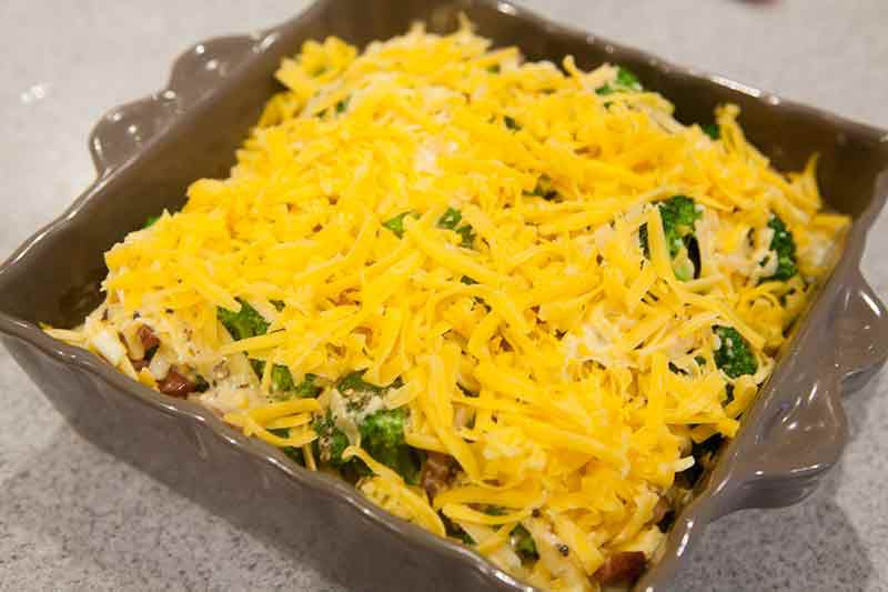 easy broccoli casserole covered in cheese