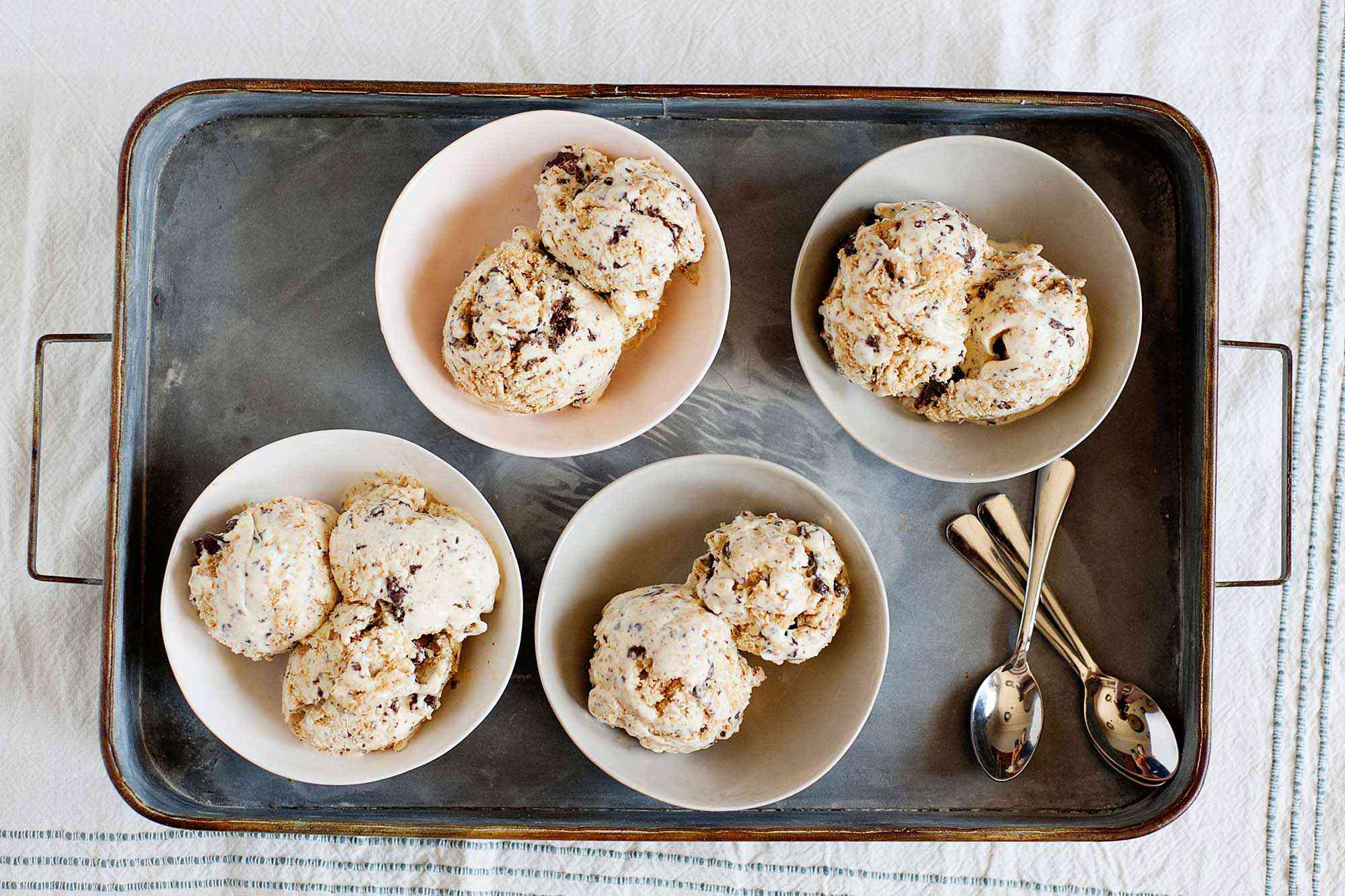 Homemade S'mores Ice Cream Recipe - scoops of ice cream in small bowls on a silver tray