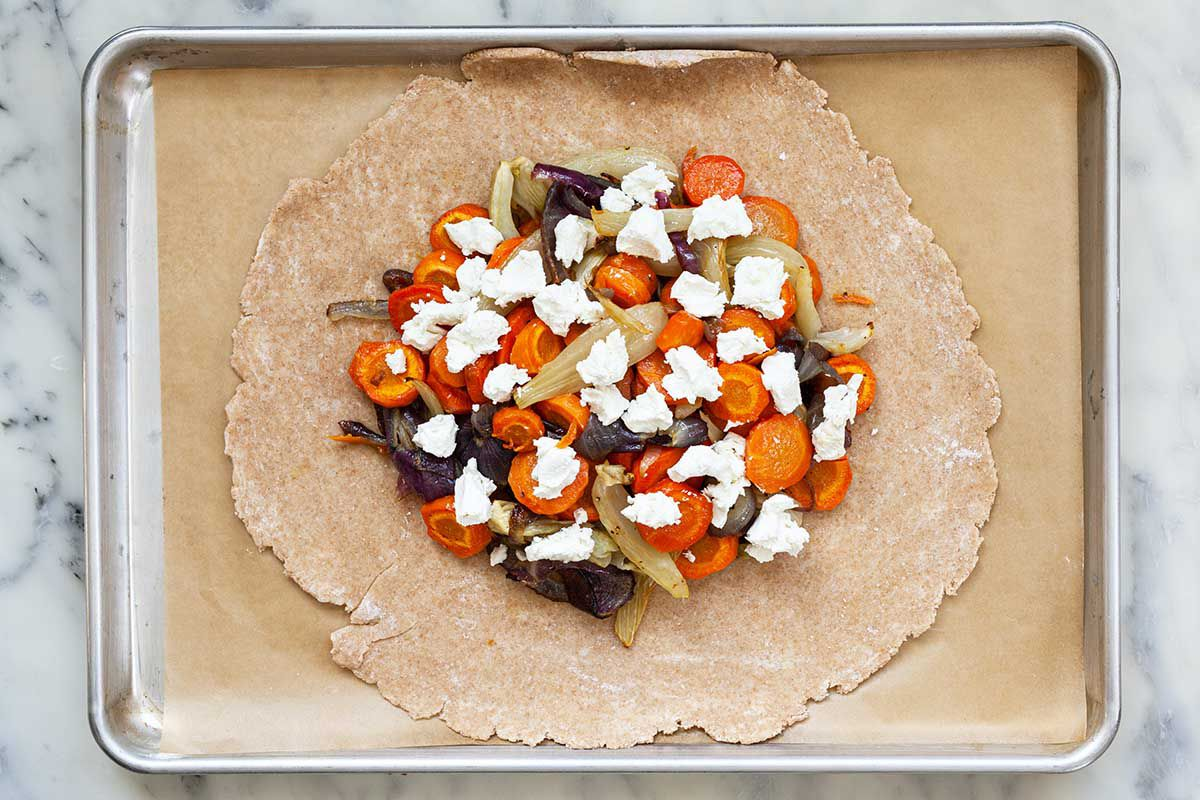 Vegetarian Tart with Carrots, Fennel and Chevre ready to be baked in the oven.