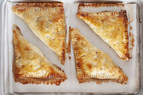 Turnover recipe shows apple turnovers baked on a sheet pan.