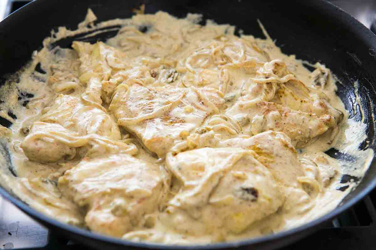 coat chicken cutlets in sour cream sauce for chicken curry in a hurry