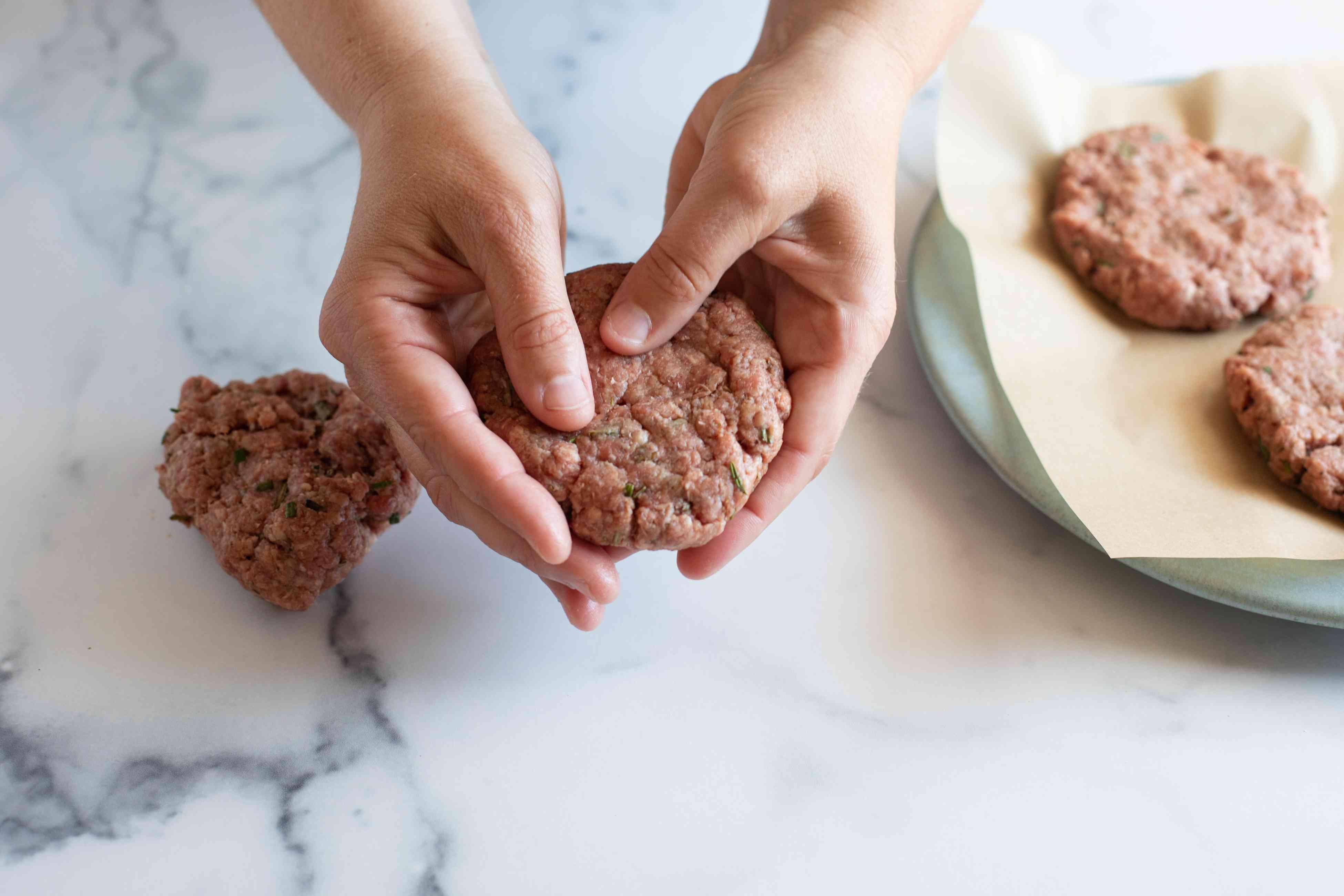 Forming hamburger patties to make a famous burger.